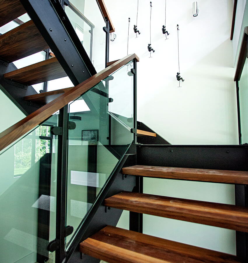 Custom Steel and Wood Staircase with Wall Art