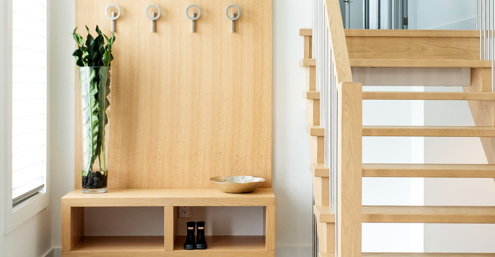 Front Entrance Coat Hangers and Wood Staircase