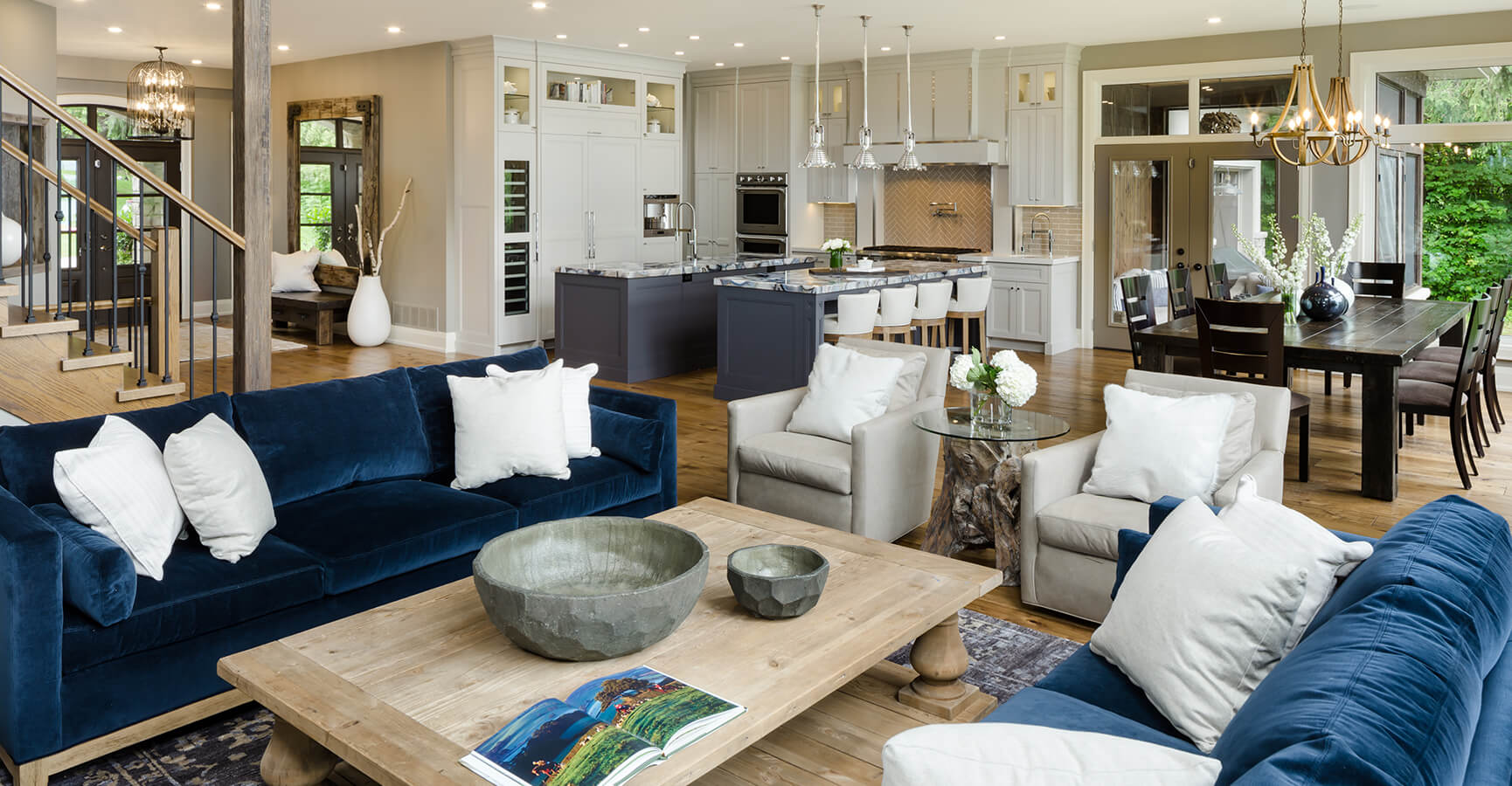 Lakeview Living Room With Kitchen and Dining Table